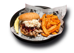 Pulled Pork Sandwich - Our slow smoked pulled pork served on a bun.
